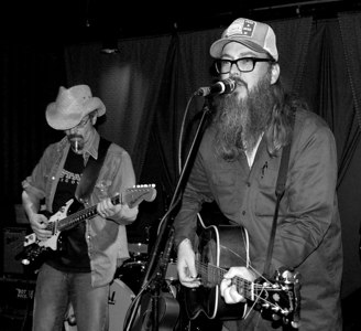 Otis Gibbs onstage with the Bottle Rockets. From his website