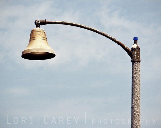 This is the way I feel some days. San Juan Capistrano, California street lights are shaped like Mission bells.