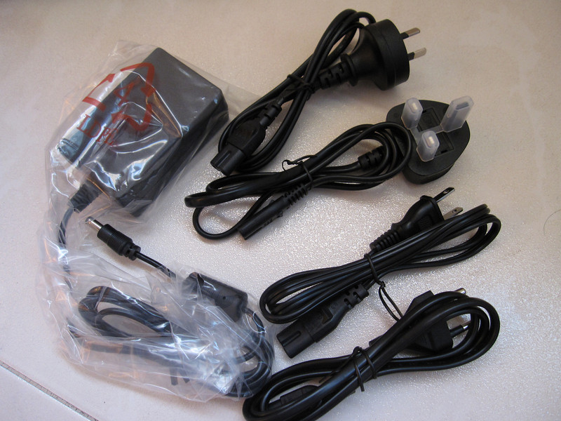 4 different sets of power cords for Iomega Mini Max 1 TB Hard Disk