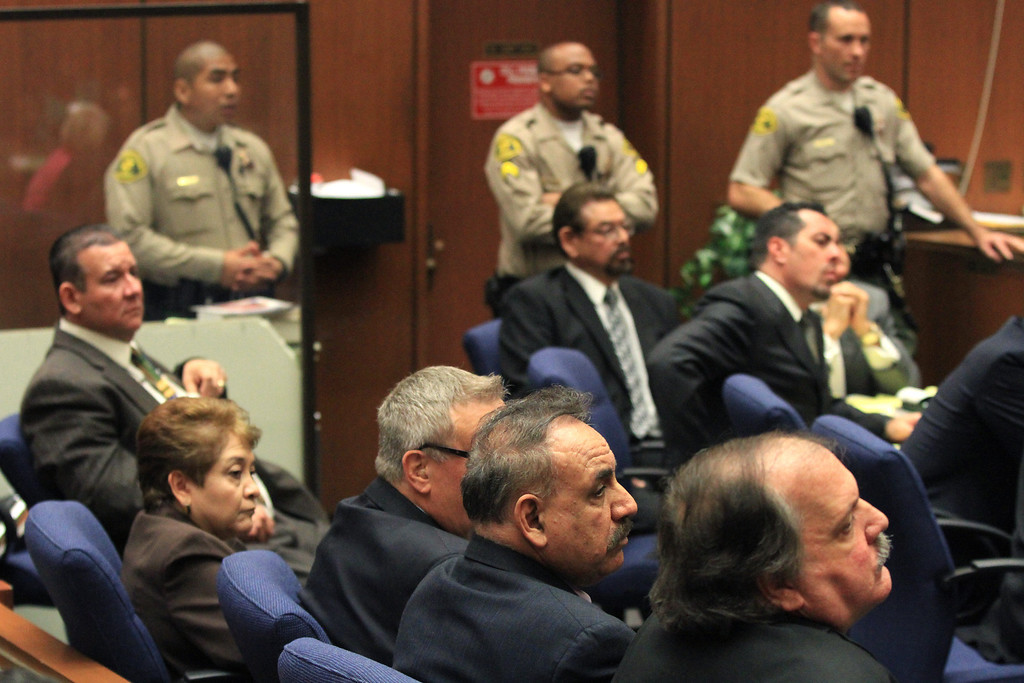 . Five former Bell City elected officials listens to the judge as a guilty verdict is read in their trial on Wednesday, March 20, 2013, in Los Angeles.  The five former elected officials were convicted of multiple counts of misappropriation of public funds, and a sixth defendant was cleared entirely. Former Mayor Oscar Hernandez and co-defendants Teresa Jacobo, George Mirabal, George Cole, and Victor Belo were all convicted of multiple counts and acquitted of others.  The charges against them involved paying themselves inflated salaries of up to $100,000 a year in the city of 36,000 people, where one in four residents live below the poverty line.   (AP Photo/Los Angeles Times, Irfan Khan, Pool)