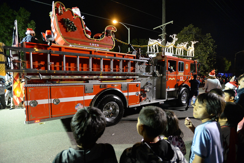 . The 60th annual Daisy Avenue Parade in the Wrigley neighborhood Saturday, December 13, 2013, in Long Beach, CA.    Santa rides upon a Long Beach fire engine and marks the end of the parade. Photo by Steve McCrank/DailyBreeze