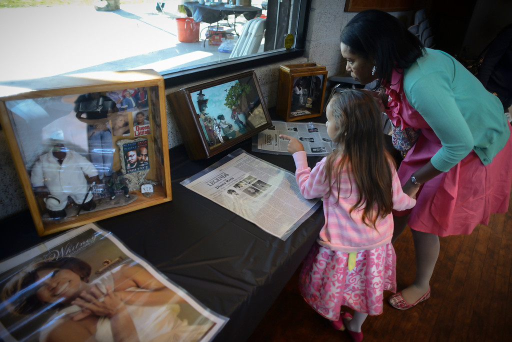 . Rosalind Nations and her daughter Summer, 5, look over miniatures by Karen Collins, Los Angeles award-winning artist, on display at the Bautista de Anza Park Community Center in Calbasas as part of Black History month.  Photo by David Crane/Staff Photographer