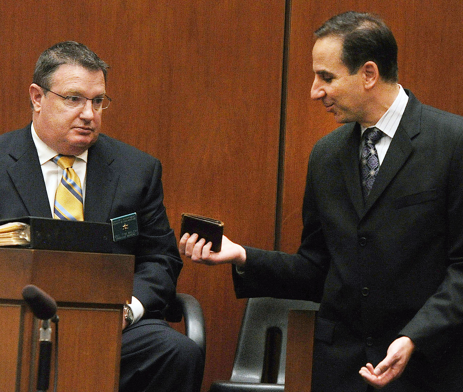 . Detective Timothy Miley who was assigned the murder case of John Sohus in San Marino August 4, 2008,  identified a  Clark Rockefeller wallet held by prosecutor Habib Balian. The wallet along with other evidence was found in Clark Rockefeller storage unit.  The murder trial of Christian Karl Gerhartsreiter, being held at Clara Shortridge Foltz Criminal Justice Center in Los Angeles Tuesday,  April 2, 2013. He has pleaded not guilty to the killing of John Sohus, 27, who disappeared with his wife, Linda, in 1985 while Gerhartsreiter was a guest cottage tenant at the home of Sohus\' mother, where the couple lived. (AP Photo/San Gabriel Valley Tribune,Walter Mancini ) MAGS OUT; NO SALES; MANDATORY CREDIT