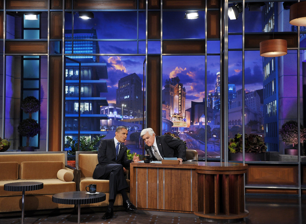 . US President Barack Obama chats with host Jay Leno during a break in the taping of  \'The Tonight Show with Jay Leno\' October 24, 2012 at NBC Studios in Burbank, California. AFP PHOTO/Mandel NGAN        (Photo credit should read MANDEL NGAN/AFP/Getty Images)