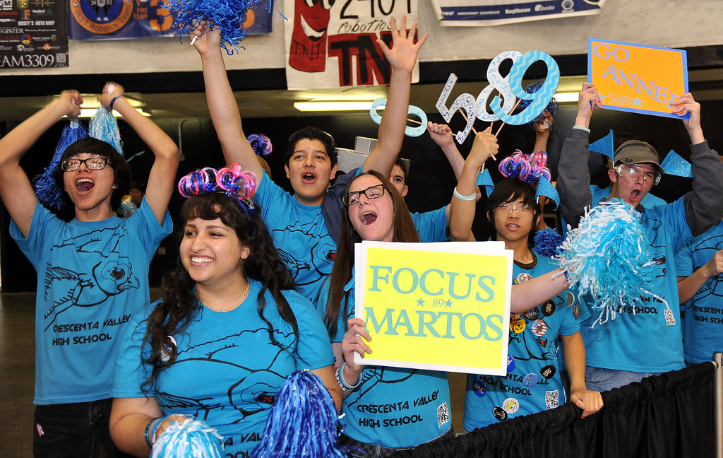 . 3/22/13 - Crescenta Valley High School cheers on their team during  the robotic competition on Friday morning. More than 1,500 high school students from California, Hawaii and Chile are competing in the 22nd FIRST Robotics Los Angeles Regional Competition at the Long Beach Arena.This years robotic task is throwing discs for points. Photo by Brittany Murray / Staff Photographer