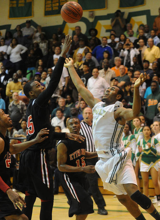 . 02-26-2012--(LANG Staff Photo by Sean Hiller)-Roschon Prince(1) is unable to get a shot off under guard of Etiwanda\'s Delewis Johnson (25) in the final seconds of overtime in Tuesday\'s CIF Southern Section Division 1AA semifinal boys basketball game at Long Beach Poly High School.  Etiwanda beat Poly the 59-55.