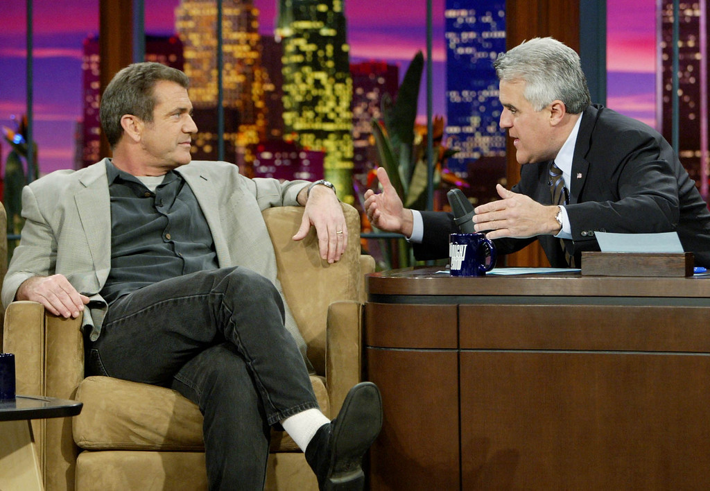 ". Mel Gibson, left, director, co-writer and producer of the new movie ""The Passion of the Christ\"", appears on the Late Show with Jay Leno Thursday, Feb. 26, 2004, in Burbank, Calif. The film opened Wednesday. (AP Photo/Ric Francis)"