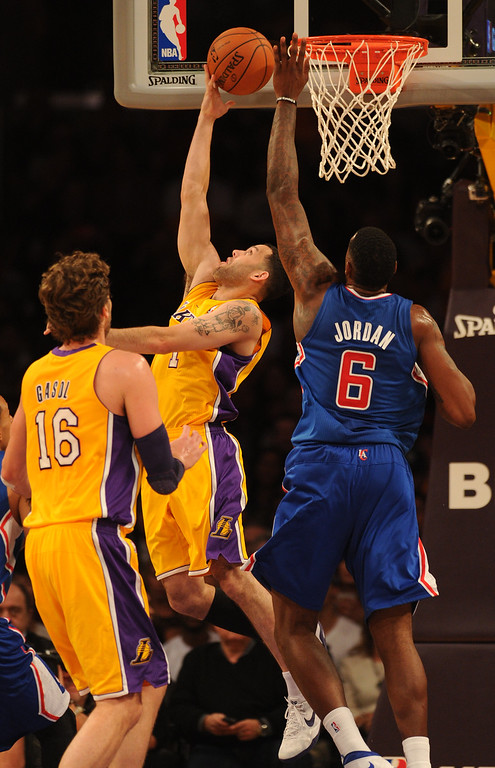 . Lakers#1 Jordan Farmar gets points against Clippers#6 DeAndre Jordan in the first quarter. The Los Angeles Lakers played the Los Angeles Clippers in the opening game of the season at Staples Center. Los Angeles, CA. 10/29/2013. photo by (John McCoy/Los Angeles Daily News)