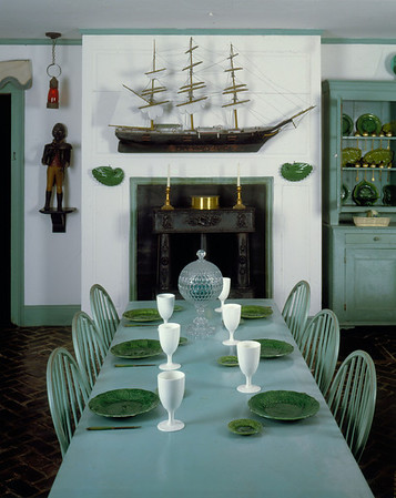 Interior view of Golden Step Room dining table with model ship over fireplace, Beauport, Gloucester, Mass.