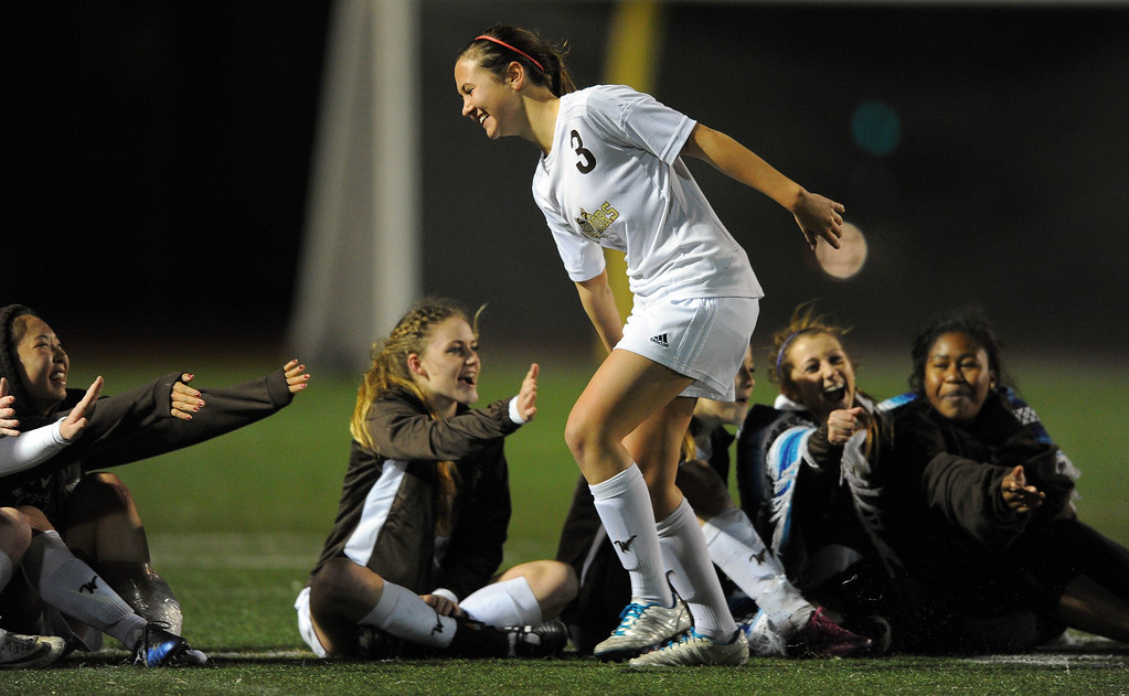 . TORRANCE - 02/12/2013 - (Staff Photo: Scott Varley/LANG) West High girls soccer beat Murrieta Valley on penalty kicks in their CIF Southern Section Division II wild-card matchup. After a 0-0 tie, West won 3-1 on PKs. West\'s Stephanie Morgan is congratulated by teammates after scoring on a penalty kick.