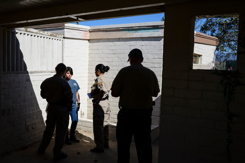 """. Members of the Arizona Highway Patrol Explorer post question the \""""victim\"""" on a domestic violence call in a drill at Pitches Detention Center Sunday.  Law enforcement explorer posts participated in a weekend-long competition to sharpen their skills.  During team events such as \""""prowler\"""", \""""felony stop\"""", \""""active shooter\"""" and \""""mud Race\"""", explorers were graded on their skills in each of the tests.  Photo by David Crane/Staff Photographer"""
