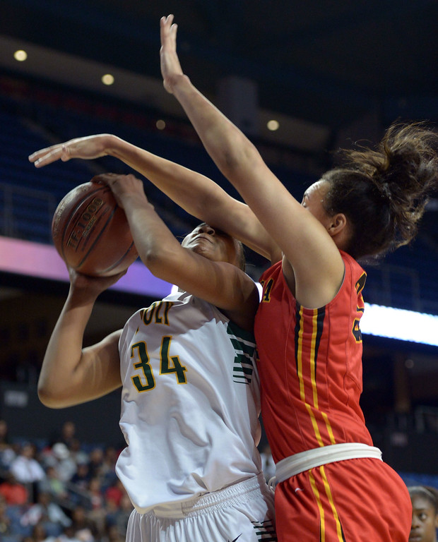 . No foul called as Poly\'s Ayanna Clark is defended by Etiwanda\'s Daeja Smith at Citizens Business Bank Arena in Ontario, CA on Saturday, March 22, 2014. Long Beach Poly vs Etiwanda in the CIF girls open division regional final. 1st half, Photo by Scott Varley, Daily Breeze)