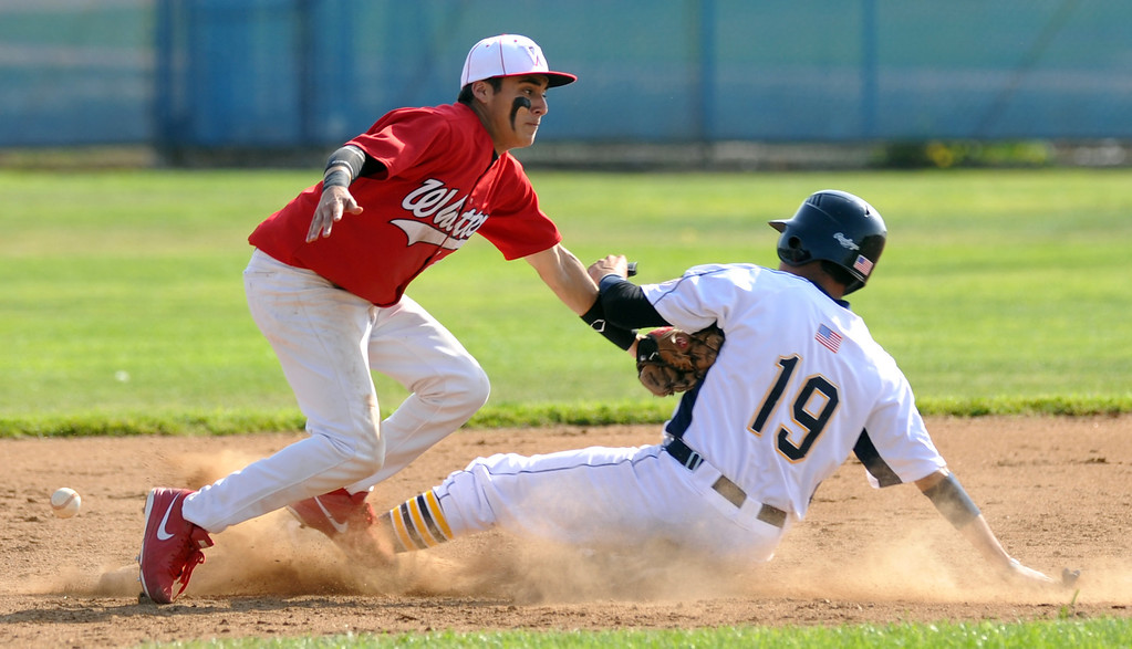 . Whittier shortstop Tommy Estrella (#18) loses the ball as California\'s Jesse Oropeza (#19) steals second base in their Del Rio League game at California High School in Whittier on Friday March 22, 2013. California beat Whittier 6-0. (SGVN/Staff Photo by Keith Durflinger)