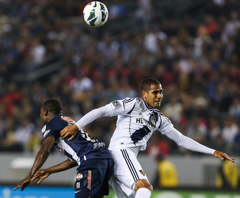 . Los Angeles Galaxy defender Leonardo, right, and Monterrey forward Sergio Santana during the CONCACAF Champions League semifinal, Wednesday, April 3, 2013, in Carson, Calif. Monterrey won 2-1. (AP Photo/Bret Hartman)