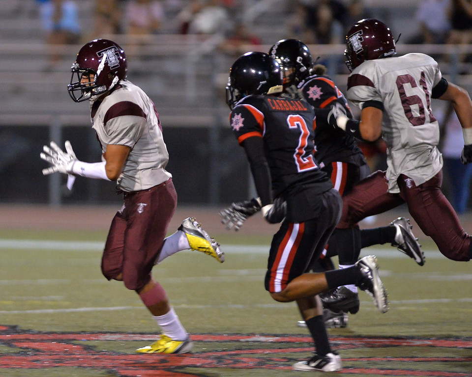 . 0907_SPT_TDB-L-TORRBANNING --Wilmington, California - - Photo: Robert Casillas / Daily Breeze -- Torrance High at Banning non league football game. Friday September 6th 2013. Torrance RB David Aros scampers for one of his two first half TD\'s.