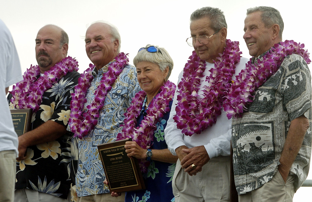 . HERMOSA BEACH - 08/01/2004 - DAILY BREEZE PHOTO: SCOTT VARLEY - Hermosa Beach Surfer\'s Walk of Fame inductions. 2004 inductees gather on stage near the Hermosa Beach pier after recieving copies of the plaques that are installed in the pier. From left, John Joseph, Sonny Vardeman, Bill Meistrell and his twin brother Bob Meistrell.