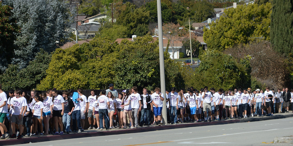 . Hundreds of Peninsula High School students took part in the school\'s Walk for Life on Wednesday which raises money for cancer research and awareness.  The students stream up Silver Spur Road on the walk which ended at Highridge Park. 20130227 Photo by Steve McCrank / Staff Photographer