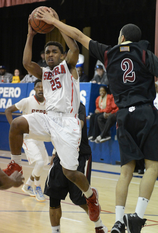 . Serra\'s Ellis Salahuddin (25) attempts a shot on the run around JSerra\'s Xavier Williams (2) in a CIF Division IV-AA quarterfinal game Tuesday night in Gardena. Serra won the game 69-66 on a buzzer beater from Jeremy Wright. 20130219 Photo by Steve McCrank / Staff Photographer