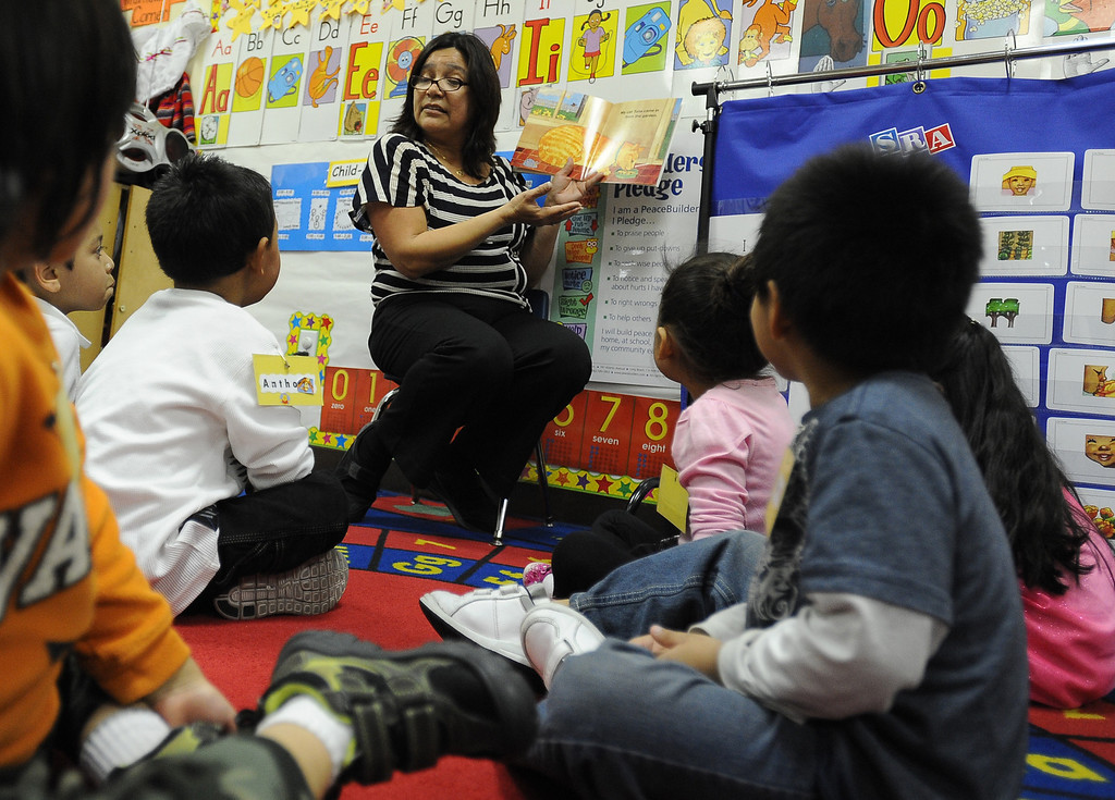 . LONG BEACH, CALIF. USA -- Teacher Margarita Gutierrez reads to students at Pine Head Start in Long Beach, Calif., on February 25, 2013.  Photo by Jeff Gritchen / Los Angeles Newspaper Group