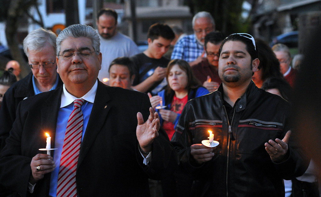 . Residents and community leaders gather for a community-wide prayer vigil at Central Park in Whittier in response to recent attempted child abductions on Friday March 15, 2013. About 150 people attended the candlelight vigil led by Pastor Sam Gamboa of the Good Shepherd Family Bible Church and organized by the Whittier Area Evangelical Ministerial Alliance. City and police officials joined citizens and area church members as they prayed for protection of the children and the arrest of the suspects. (SGVN/Staff Photo by Keith Durflinger)