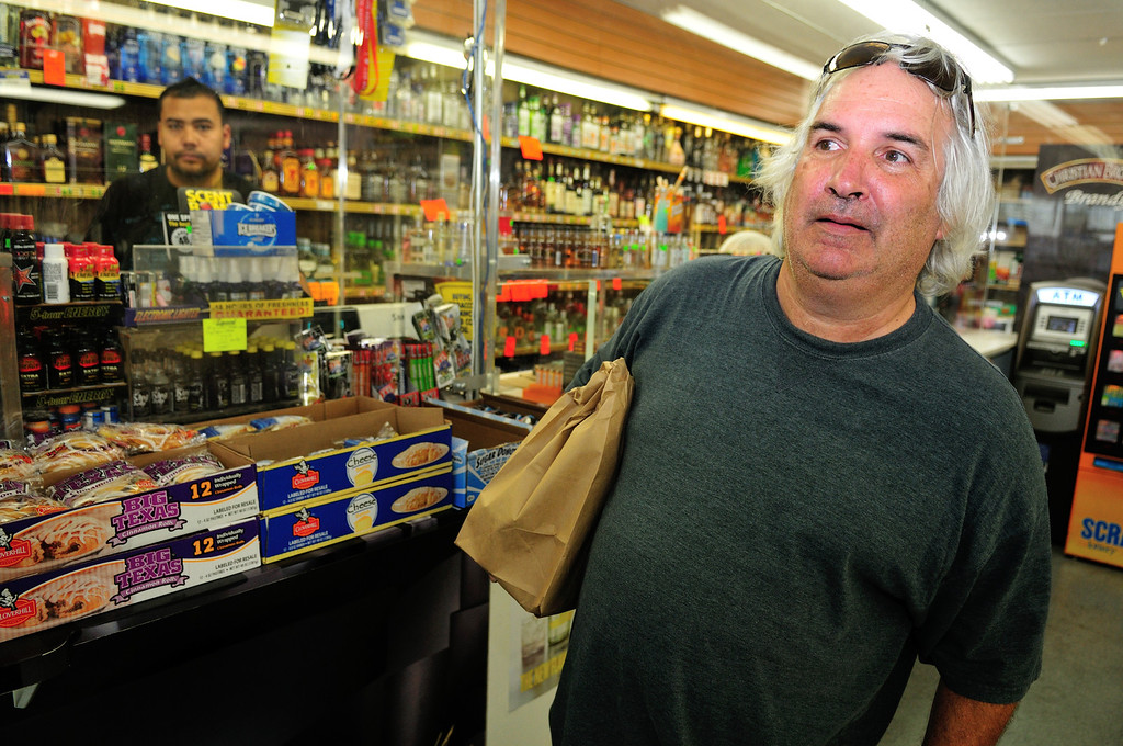 . Tim Grobaty stocks up on supplies from Eddies Liquor Market down the street from his room at the El Capitan Motor Inn.Photo by Thomas Wasper for the Press Telegram