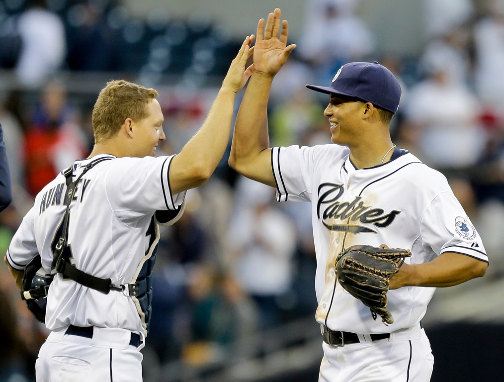 . San Diego Padres\' Will Venable, right, and Nick Hundley high five after the Padres\' 9-3 victory over the Los Angeles Dodgers in the Padres\' home opener baseball game  in San Diego, Tuesday, April 9, 2013.  Venable homered and tripled while driving in  four runs and Hundley also homered. (AP Photo/Lenny Ignelzi)