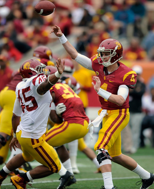 . QB Max Browne passes under pressure from DE Charles Burks during USC\'s Spring Football Game at the L.A. Memorial Coliseum, Saturday, April 13, 2013. (Michael Owen Baker/Staff Photographer)