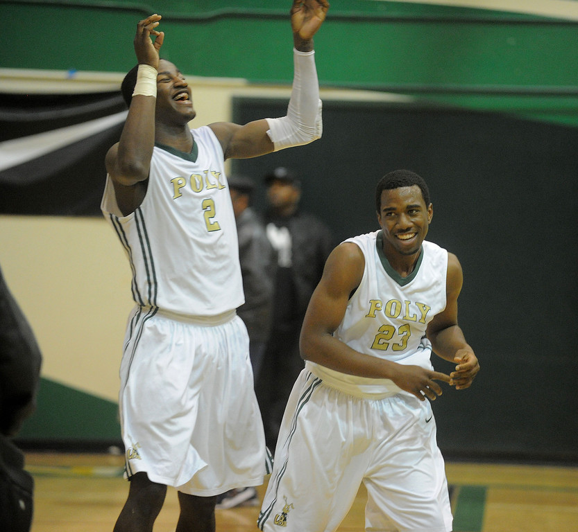 . 02-19-2012--(LANG Staff Photo by Sean Hiller)-Jordan Bell, left, and Aaron Blair are all smiles after Poly defeated Mayfair 73-28 in the second round of the Division I-AA boys basketball playoffs Tuesday night.