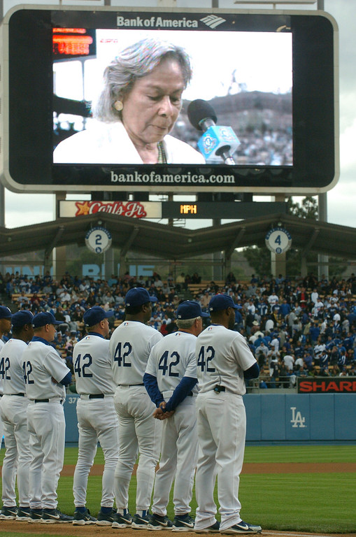 Description of . Dodger players all wear #42 on their jerseys in honor of Jackie Robinson while Jackie's widow, Rachel Robinson, speaks to the crowd and is shown on the jumbotron at Dodger Stadium against the San Diego Padres, Sunday April 15, 2007. (Michael Owen Baker/Los Angeles Daily News)