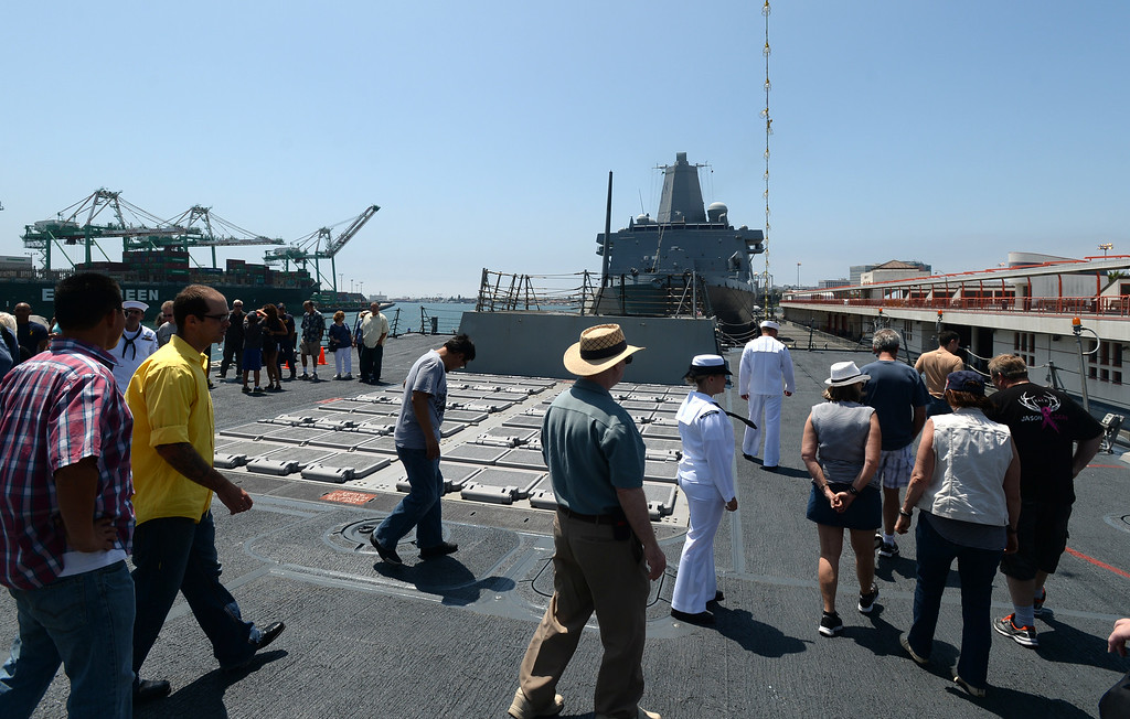 . People take a tour of the USS Spruance, an Arleigh Burke-class guided missile destroyer, which is docked in the Port of Los Angeles for Navy Days.  At the aft of the ship are the hatches where cruise missiles, such as Tomahawks, are launched from. Saturday, August 09, 2014, San Pedro, CA.   Photo by Steve McCrank/Daily Breeze