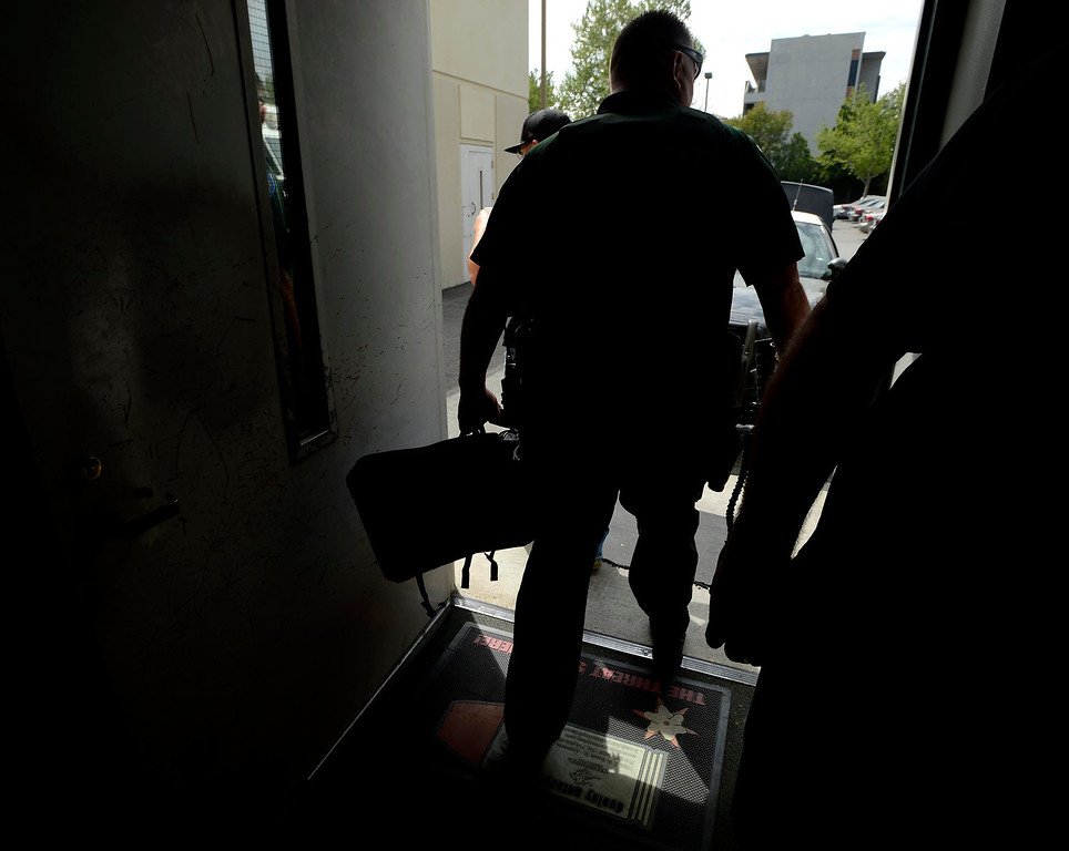 Description of . San Bernardino Police SMASH Unit officer Ray Bonshire leaves the SBPD headquarters to participate in a sweep of downtown San Bernardino April 4, 2013. GABRIEL LUIS ACOSTA/STAFF PHOTOGRAPHER.