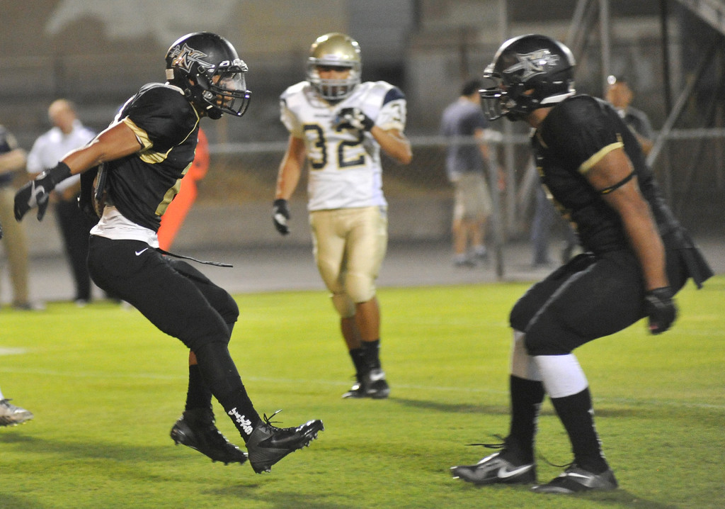 Description of . Northview plays Rowland in their non-league game at Covina District Field in Covina on Friday September 13, 2013. Northview beat Rowland 28-0. (San Gabriel Valley Tribune/Staff Photo by Keith Durflinger)