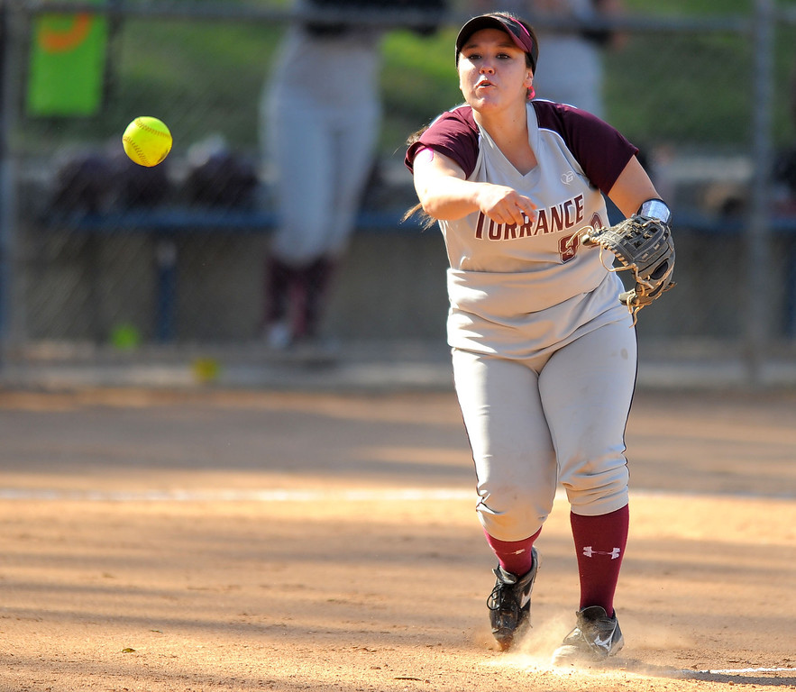 . TORRANCE - 04/03/2013  (Photo: Scott Varley, Los Angeles Newspaper Group)  South vs Torrance softball in a Pioneer League matchup. Torrance 3B Lexi Ponce throws a batter out at 1B.
