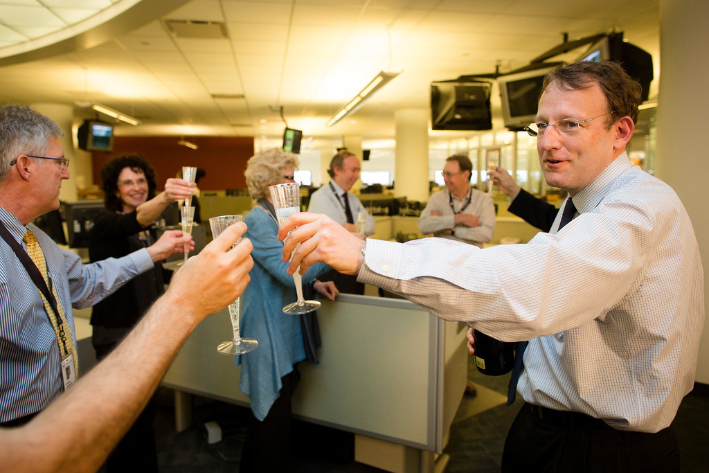 . Santiago Lyon, Director of Photography and Vice President, toasts with champagne after announcing their Associated Press photographers Rodrigo Abd, Manu Brabo, Narciso Contreras, Khalil Hamra,, and Muhammed Muheisen won the the 2013 Pulitzer Prize for Breaking News Photography for their work covering the Syrian civil war, Monday, April 15, 2013, in New York. (AP Photo/John Minchillo)