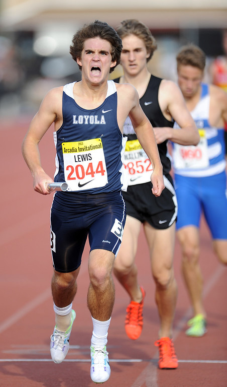 Description of . Loyola's Josh Lewis of Pasadena reacts after running the anchor leg to win the 4x800 Invitational during the Arcadia Invitational at Arcadia High School on Friday, April 5, 2013 in Arcadia, Calif.  (Keith Birmingham Pasadena Star-News)