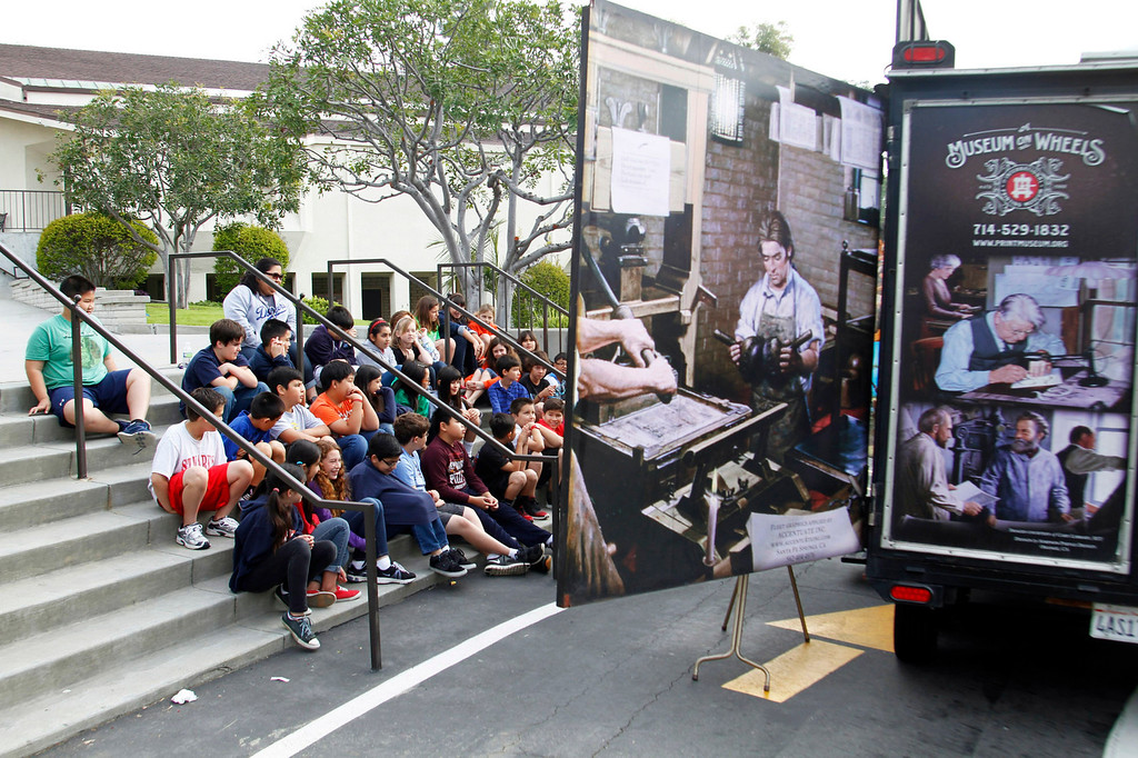 ". Fifth graders listen to Mark Barbour, Executive Director and Curator of the International Printing Museum, on a history leason of books and printing before Gutenberg to Benjamin Franklin\'s, using his ""Museum on Wheels\"" to the fifth grade class, at St. Marks Luthern School, in Hacienda Heights, Thursday, March 28, 2013. (Correspondent Photo by James Carbone/HIGH)"