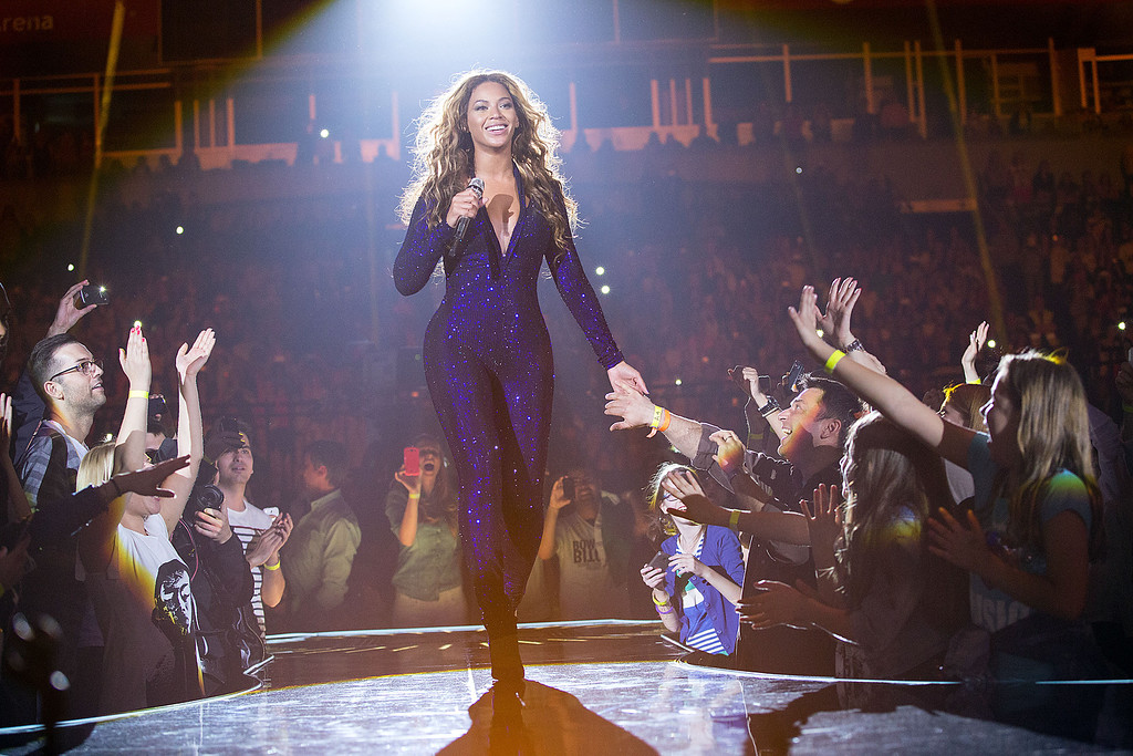 """. Singer Beyonce performs on the opening night of her \""""Mrs. Carter Show World Tour 2013\"""", on Monday, April 15, 2013 at the Kombank Arena in Belgrade, Serbia. Beyonce is wearing a cobalt blue hand beaded jumpsuit by designer Vrettos Vrettakos. (Photo by Yosra El-Essawy/Invision for Parkwood Entertainment/AP Images)"""