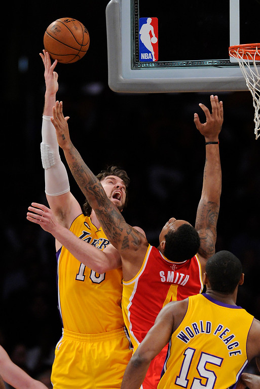 . Lakers#16 Pau Gasol shoots a hook shot over Rockets#4 Greg Smith in the first quarter. The Lakers faced the Houston Rockets in the final home game of the year at Staples Center in Los Angeles, CA 4/17/2013(John McCoy/Staff PhotographerThe Lakers faced the Houston Rockets in the final home game of the year at Staples Center in Los Angeles, CA 4/17/2013(John McCoy/Staff Photographer