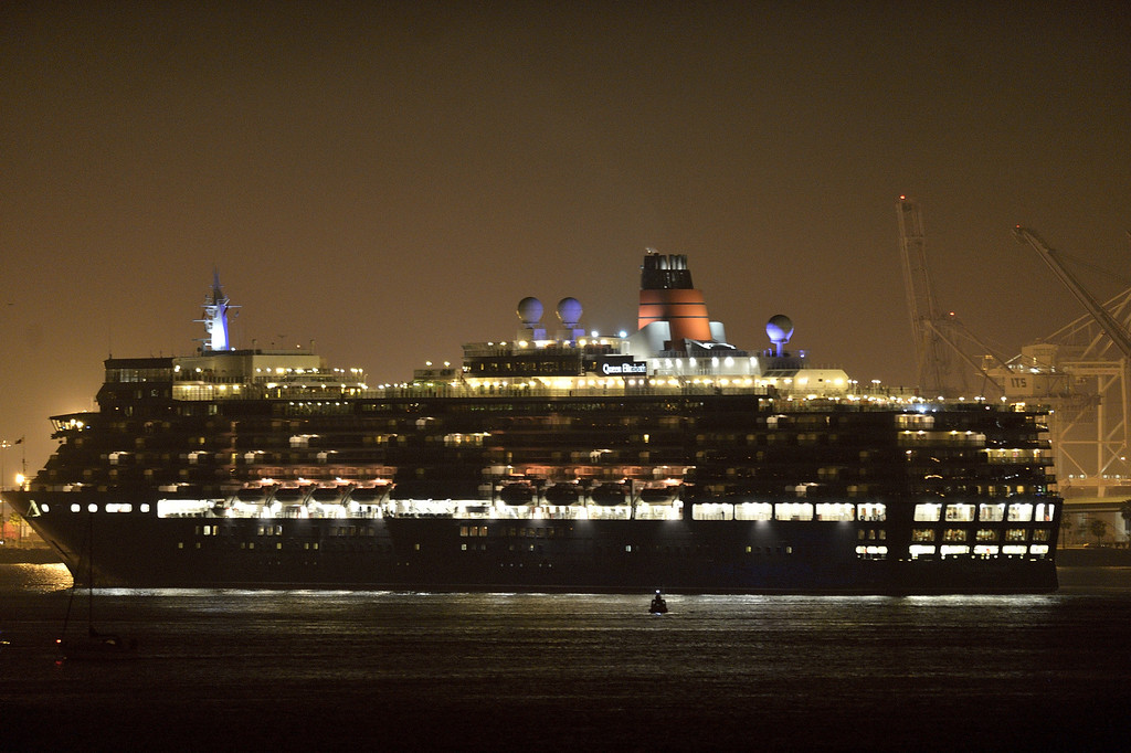 . LONG BEACH, CALIF. USA -- The youngest Cunard Line ship, Queen Elizabeth, heads out of Long Beach (Calif.) Harbor after visiting the Queen Mary on March 12, 2013. The Queen Mary was built by Cunard in 1936 and retired in 1967. The Queen Mary, now a permanently berthed, is a hotel and special events venue. The two ships exchanged whistle blows.  