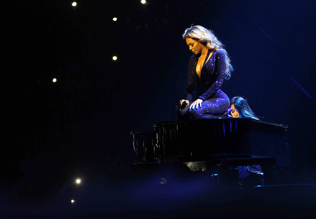 """. Singer Beyonce performs on the opening night of her \""""Mrs. Carter Show World Tour 2013\"""", on Monday, April 15, 2013 at the Kombank Arena in Belgrade, Serbia. Beyonce is wearing a cobalt blue hand beaded jumpsuit by designer Vrettos Vrettakos.(Photo by Yosra El-Essawy/Invision for Parkwood Entertainment/AP Images)"""