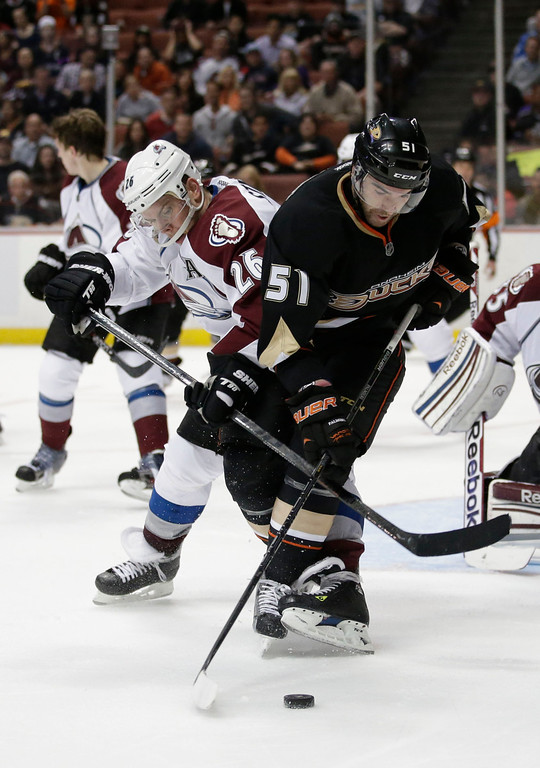 . Anaheim Ducks\' Kyle Palmieri, right, and Colorado Avalanche\'s Paul Stastny fight for the puck during the second period of an NHL hockey game in Anaheim, Calif., Wednesday, April 10, 2013. (AP Photo/Jae C. Hong)