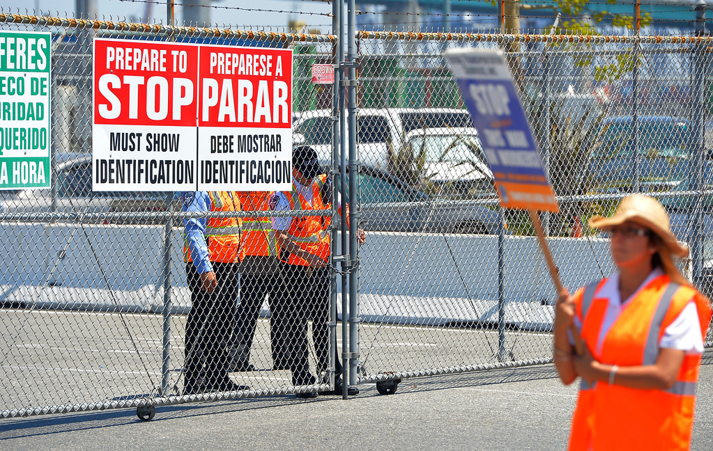 . Security guards at the Evergreen terminal briefly lockdown the gates to incoming trucks before opening them back up again a few minutes later on Terminal Island, CA on Wednesday, July 9, 2014.  (Photo by Scott Varley, Daily Breeze)