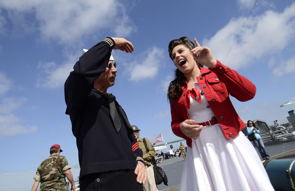 . SAN PEDRO, CALIF. USA -- Pin-up girl Jamie Beman and Dan Whitney, WWII navy  uniform, during the 70th. birthday celebration of the USS Iowa in San Pedro, Calif. on February 17, 2013. Photo by Jeff Gritchen / Los Angeles Newspaper Group