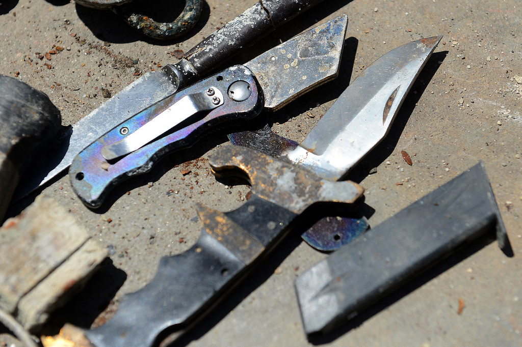 . Knives and a gun clip found in the lake at Red Hill Park in Rancho Cucamonga, CA, Thursday, June 5, 2014. (Photo by Jennifer Cappuccio Maher/Inland Valley Daily Bulletin)