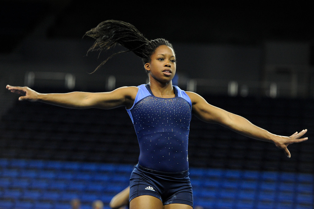 . UCLA\'s Sadiqua Bynum practices a floor exercise. (Michael Owen Baker/Staff Photographer)