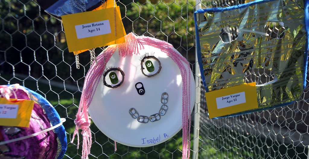Description of . Students display their recycled materials art in the