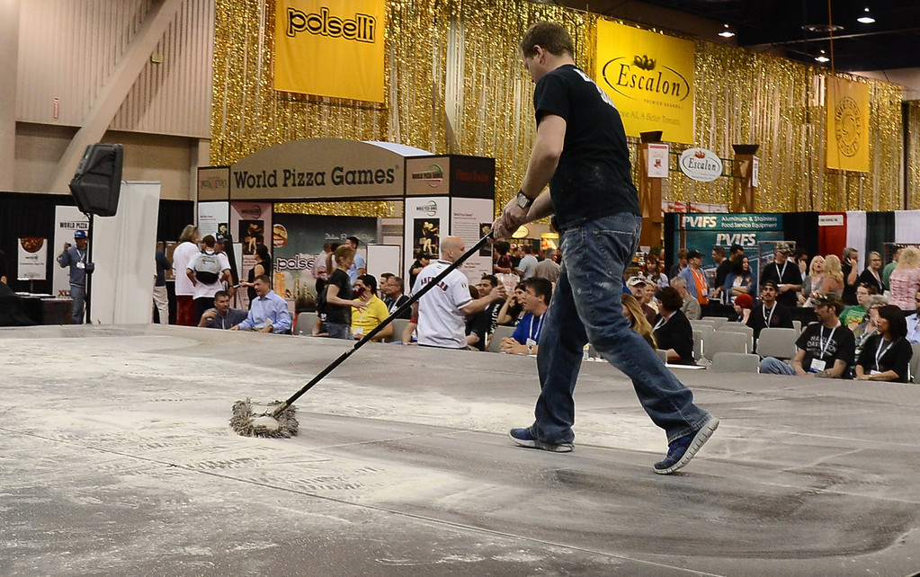 . March 19,2013. Las Vegas NV. USA. Pounds of flower his swept up during the world pizza games at the 2013 International Pizza Expo. Photo by Gene Blevins/LA DailyNews