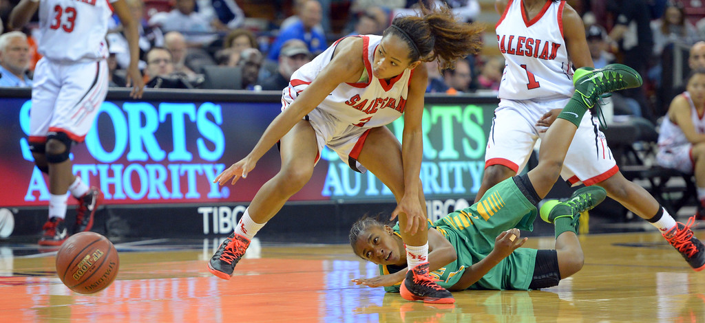 . Poly\'s Danae Miller loses the ball after getting tripped up as it rolls past Salesian\'s Minyon Moore at Sleep Train Arena in Sacramento, CA on Saturday, March 29, 2014. Long Beach Poly vs Salesian in the CIF Open Div girls basketball state final. 2nd half. Poly won 70-52. (Photo by Scott Varley, Daily Breeze)