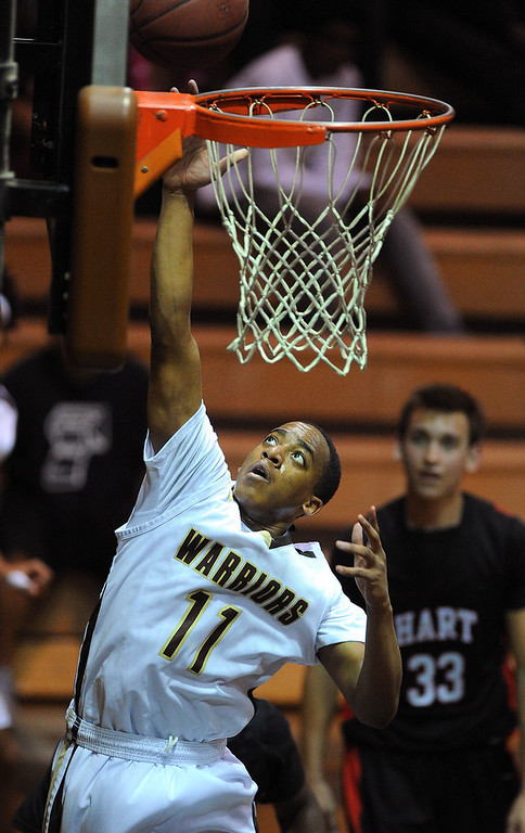 . TORRANCE - 02/15/2013 - (Staff Photo: Scott Varley/LANG) In a CIF Southern Section Division III-AAA second-round boys basketball matchup, West beat Hart 64-55. West\'s Christian Jackson lays in a basket.