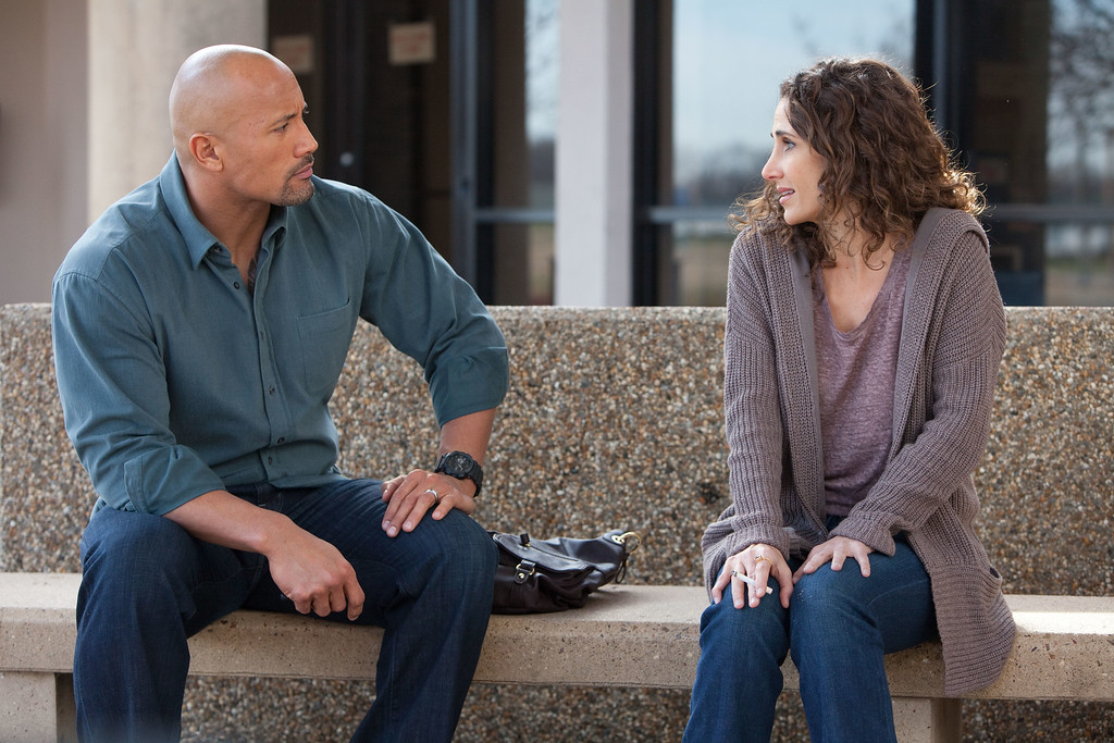 ". This film image released by Summit Entertainment shows Dwayne Johnson, left, and Melina Kanakaredes in a scene from ""Snitch.\"" (AP Photo/Summit Entertainment, Steve Dietl)"